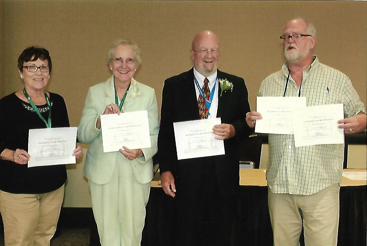 award winners posing for a photo at a conference